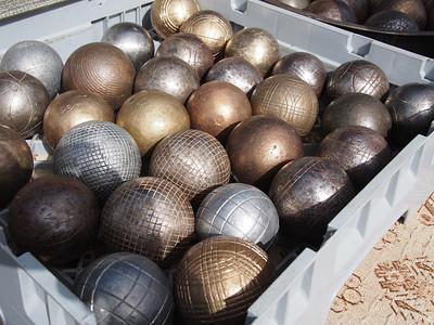 Fête de la transhumance à Saint-Rémy-de-Provence. Old metal studded petanque boules for sale in the flea market.