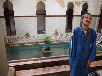 One-armed latrine attendant, Medina, Fez