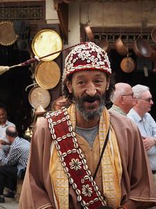 Tassel-twirling street dancer, Medina, Fez
