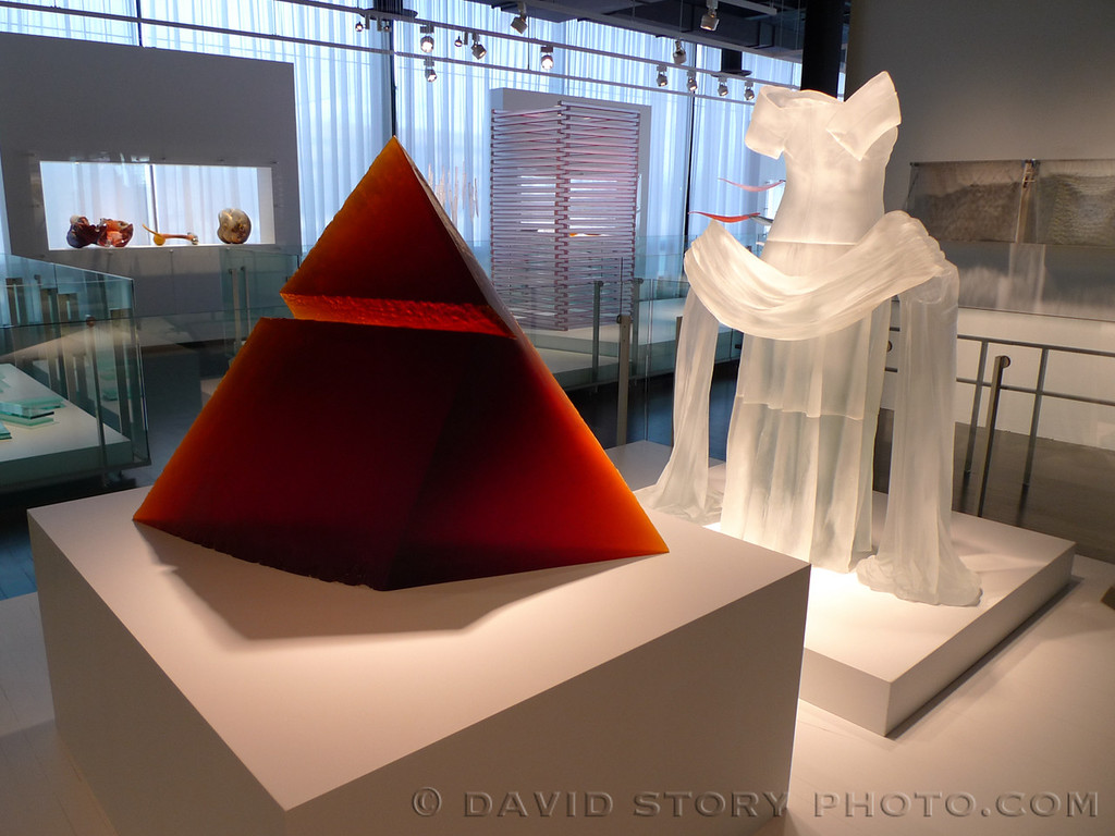 Red Pyramid by Stanislav Libensky´ and Jaroslava Brychtova´ and Evening Dress with Shawl by Karen LaMonte in the Ben W. Heineman Sr. Family Gallery of Contemporary Glass at the Corning Museum of Glass.