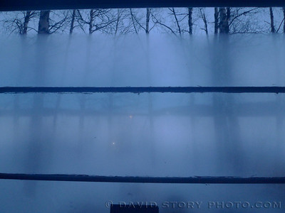 A fogged window helps darkness fall over Nancy Lake.