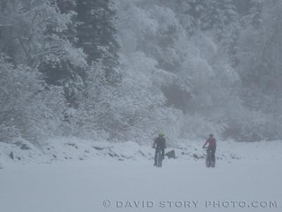 Fat biking on Upper Trail Lake. Moose Pass, AK