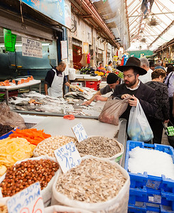 Jerusalem, Israel - November 15, 2012 - people are shopping at Mahane Yehuda - famous market in Jeru