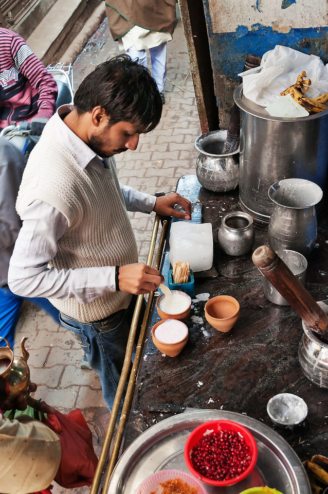 Indian Milkman Prepares The Popular Drink Lassi In Blue Lassi Shop