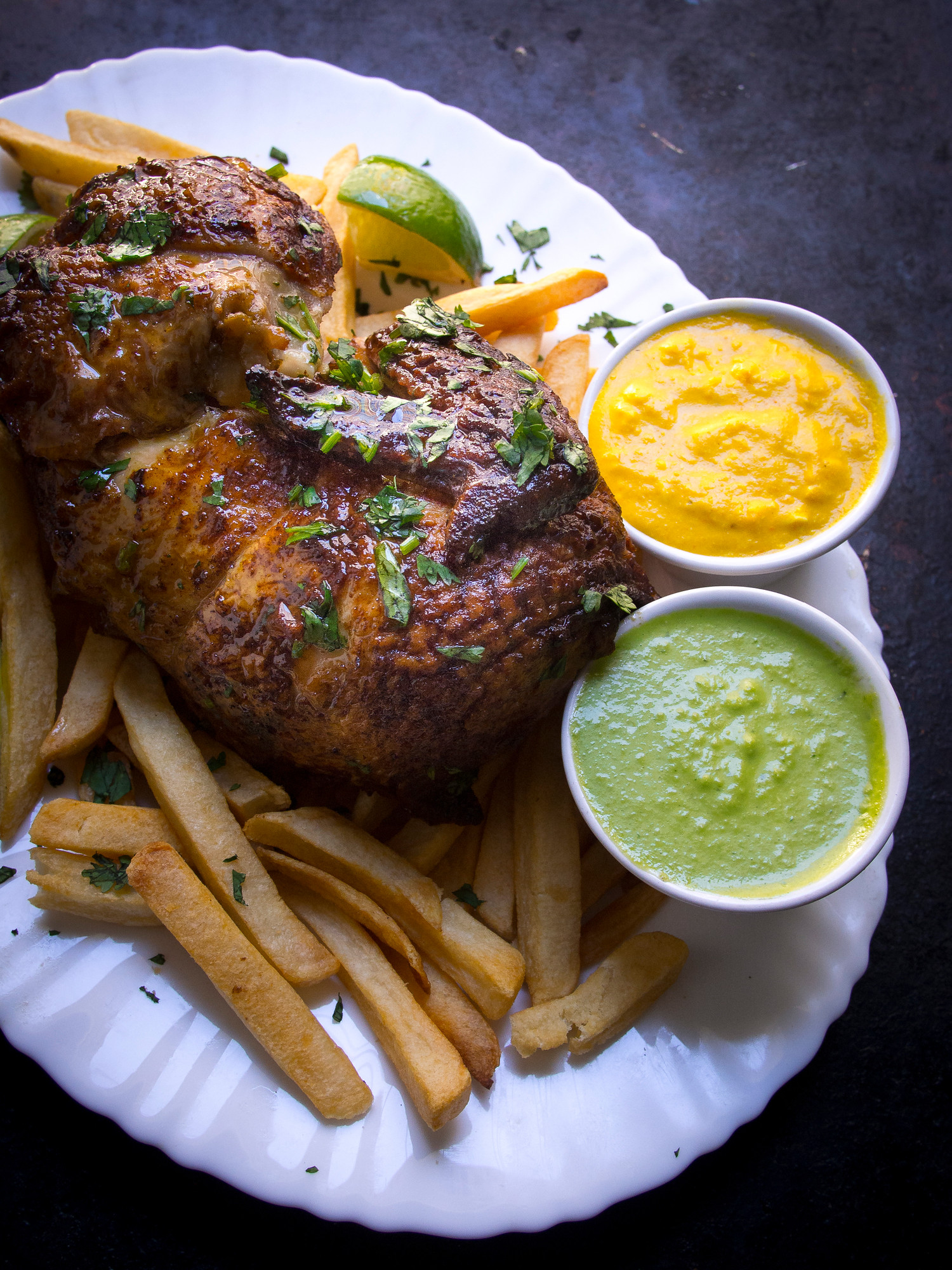 Pollo a la brasa is an easy Peruvian chicken recipe with incredible hot sauces aji verde and aji amarillo.