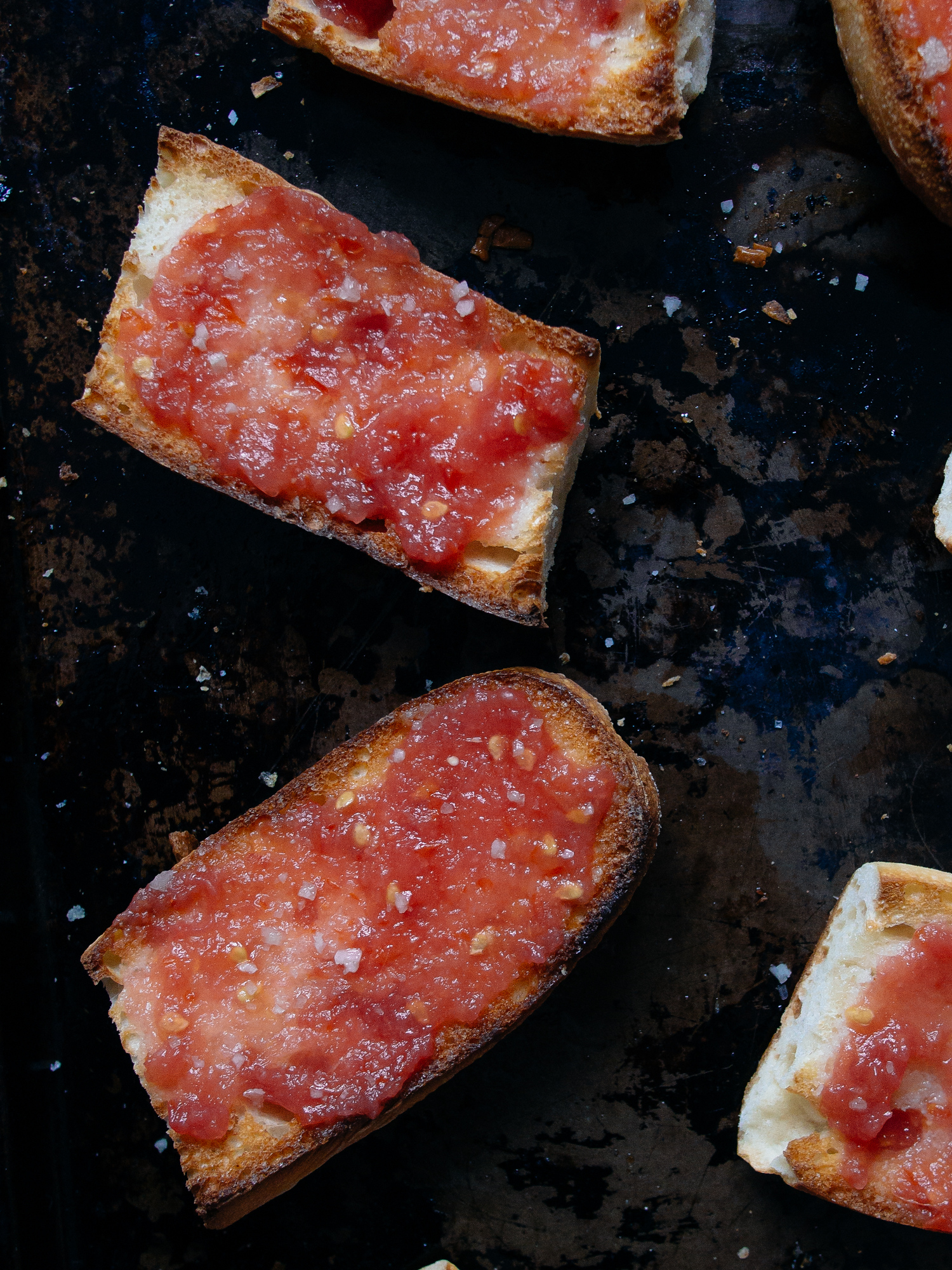 Pa amb tomaquet is Catalan tomato bread often called pan con tomate. Here's the authentic recipe with a few ways to make it easier to make.
