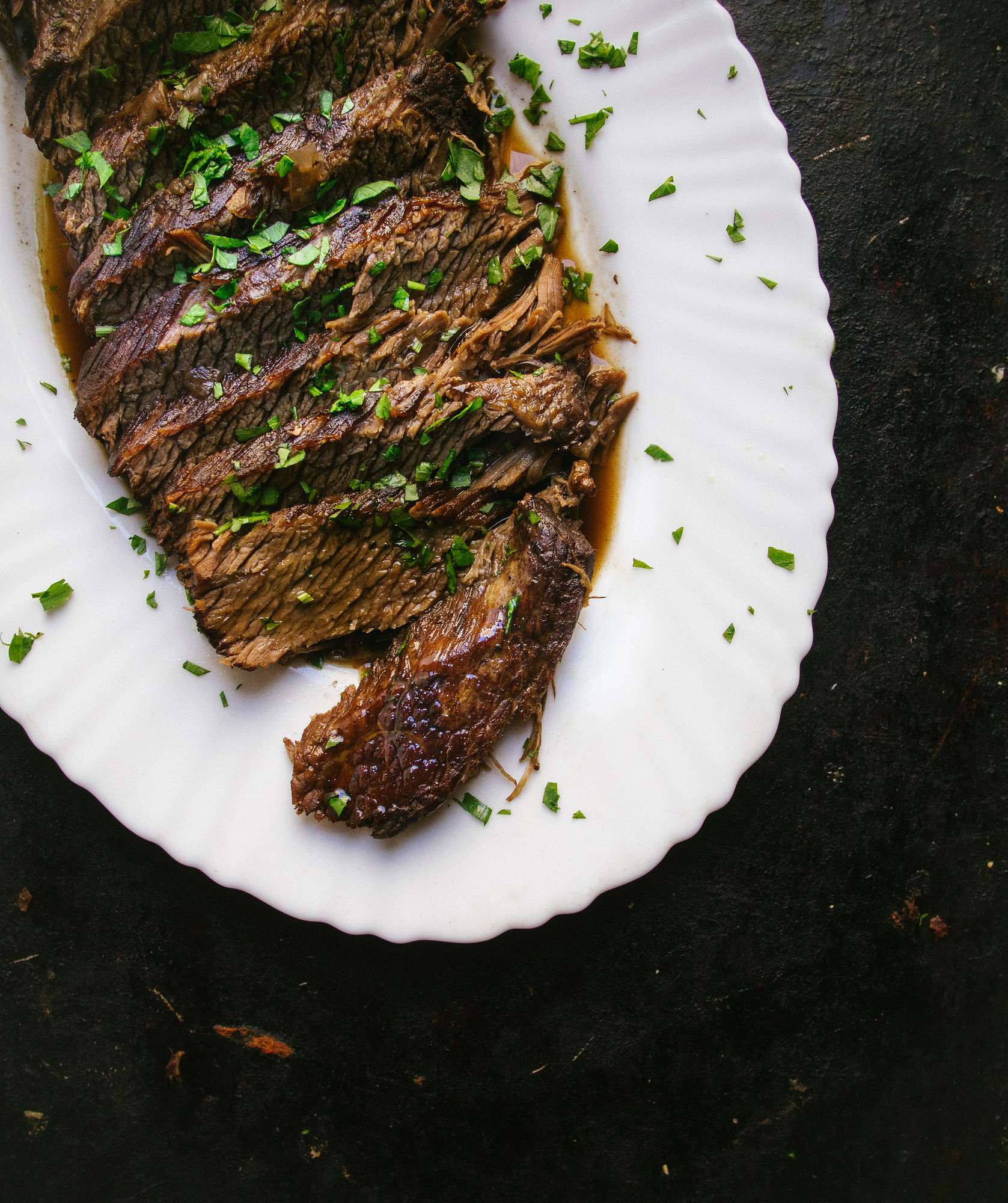This Instant Pot braised brisket with red wine can be made in under an hour and is perfect for having guests over a weeknight dinner.