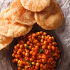 Delicious Indian Chana Masala And Puri Close-up. Vertical Top View