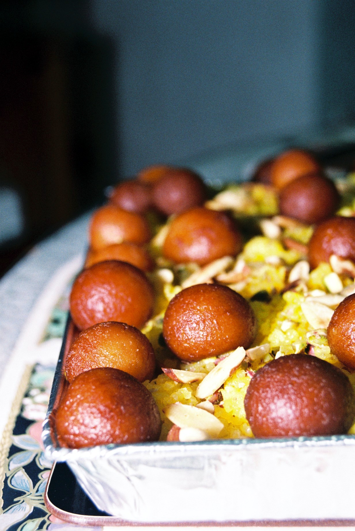 Gulab Jamun are fried dough drizzled with syrup in India and one of the Diwali festival foods you must try. Discover the other 22 foods.