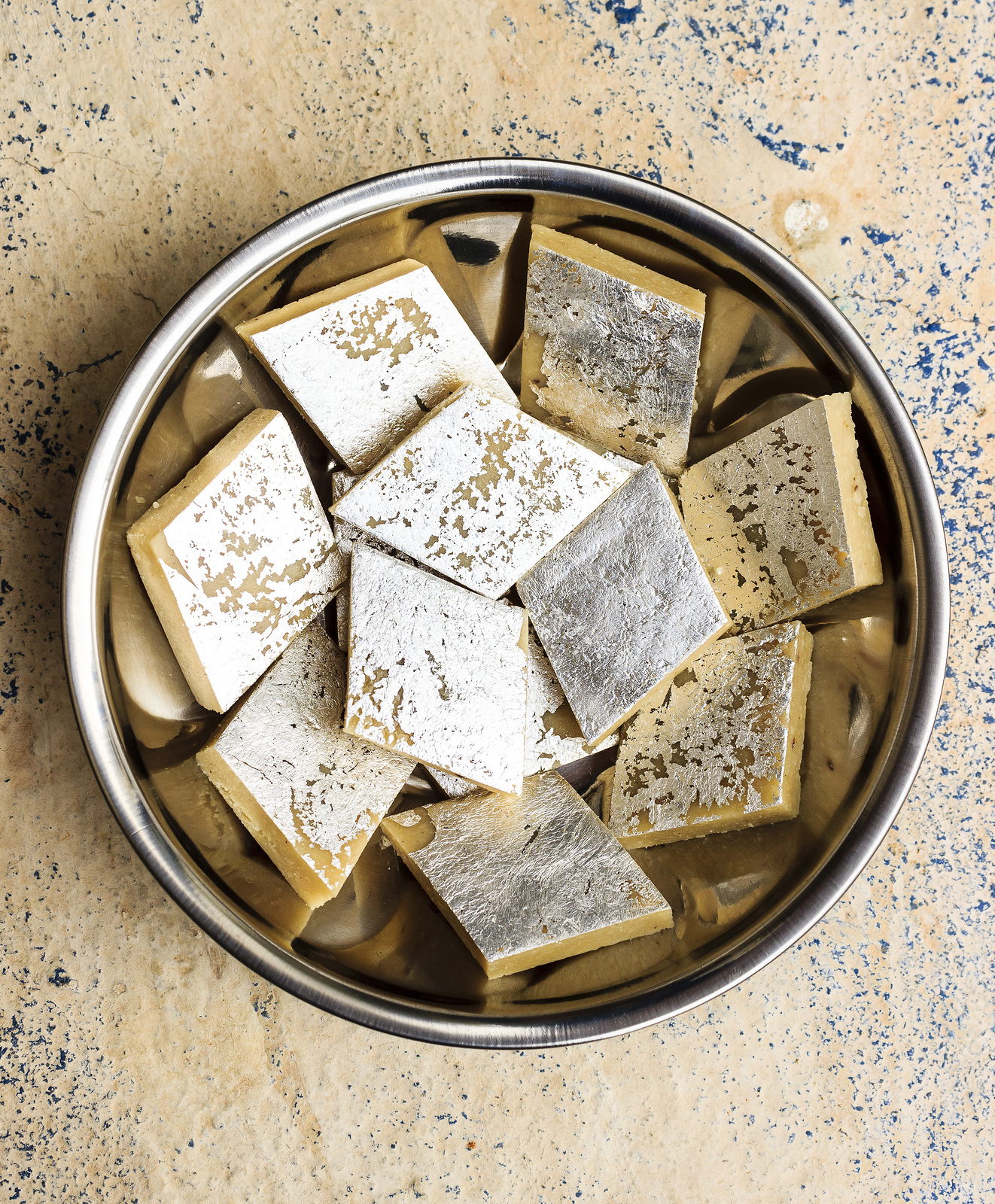 Kaju Katli are diamond shaped cashew sweets from India and one of the Diwali festival foods you must try. Discover the other 22 foods.