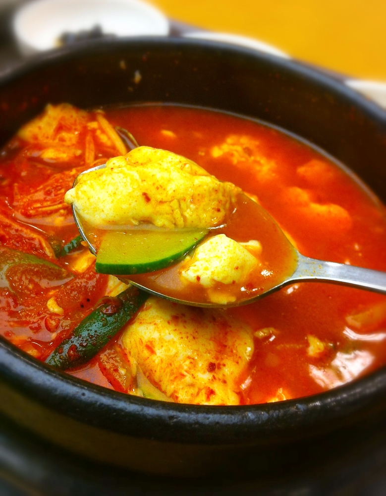 Korean food: Soondubu jjigae, also known as tofu kimchi soup, is just one of 30 traditional Korean foods you should try in South Korea.