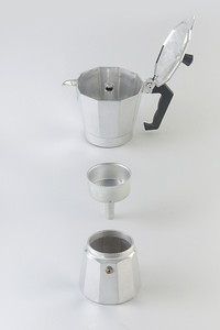 Exploded view of a moka pot on background white