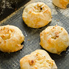 Knishes with potato and onion on baking sheet - Jewish pastry