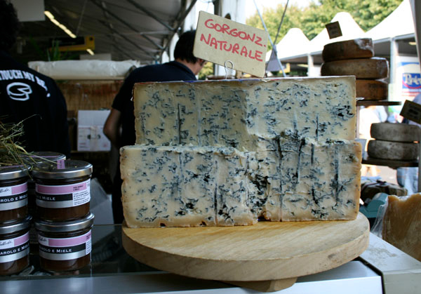 Gorgonzola is a common Milan food found in markets like this one.