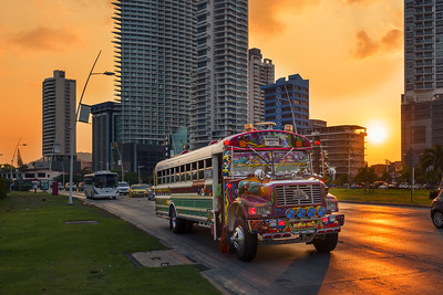 Panama City Panama - March 18 2014: A Red Devil bus in Panama City with modern building on the background at sunset in Panama.