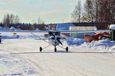 A small airplane taxis to the runway.