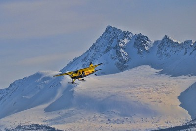 Plane with skis coming in for a landing to Lake Hood - Anchorage, Alaska