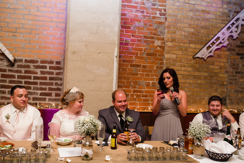 Early on in Matt and Audrey's wedding reception, there were toasts and candid moments with the guests at Blumen Gardens.