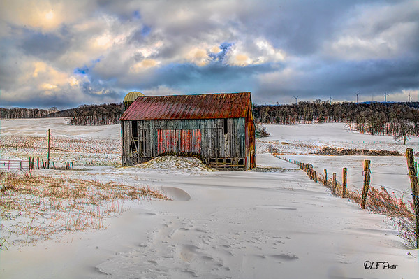 Old barn in middle field in the snow
