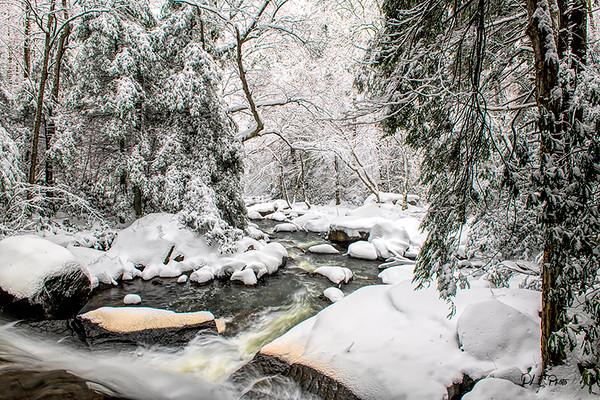 A stream after a heavy snowfall