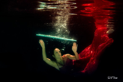 Woman swimming in pool with her flute