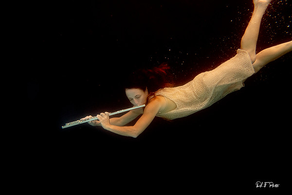 Artist magically floating with her flute 81