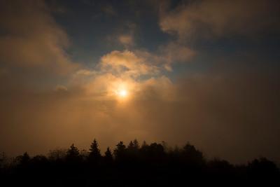 Morning sun sneaking through fog  on Bald Knob Mountain
