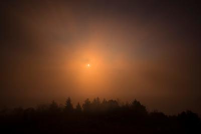 Sun burning through the fog on Bald Knob