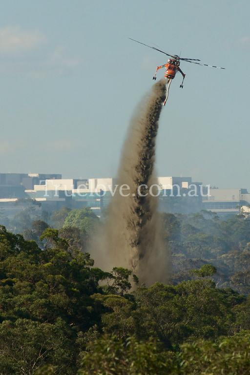 5.12.21013<br /> <br /> A North Ryde bushfire being attended to by firefighters with an Erickson Air Crane helicopter in the Lane Cove National Park,  Sydney. The air-crane can suction up 10,000L in 45 seconds, from the Lane Cove River. <br /> <br /> © Tess Peni