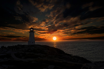 Sunset behind lighthouse at Peggy's Cove Nova Scotia