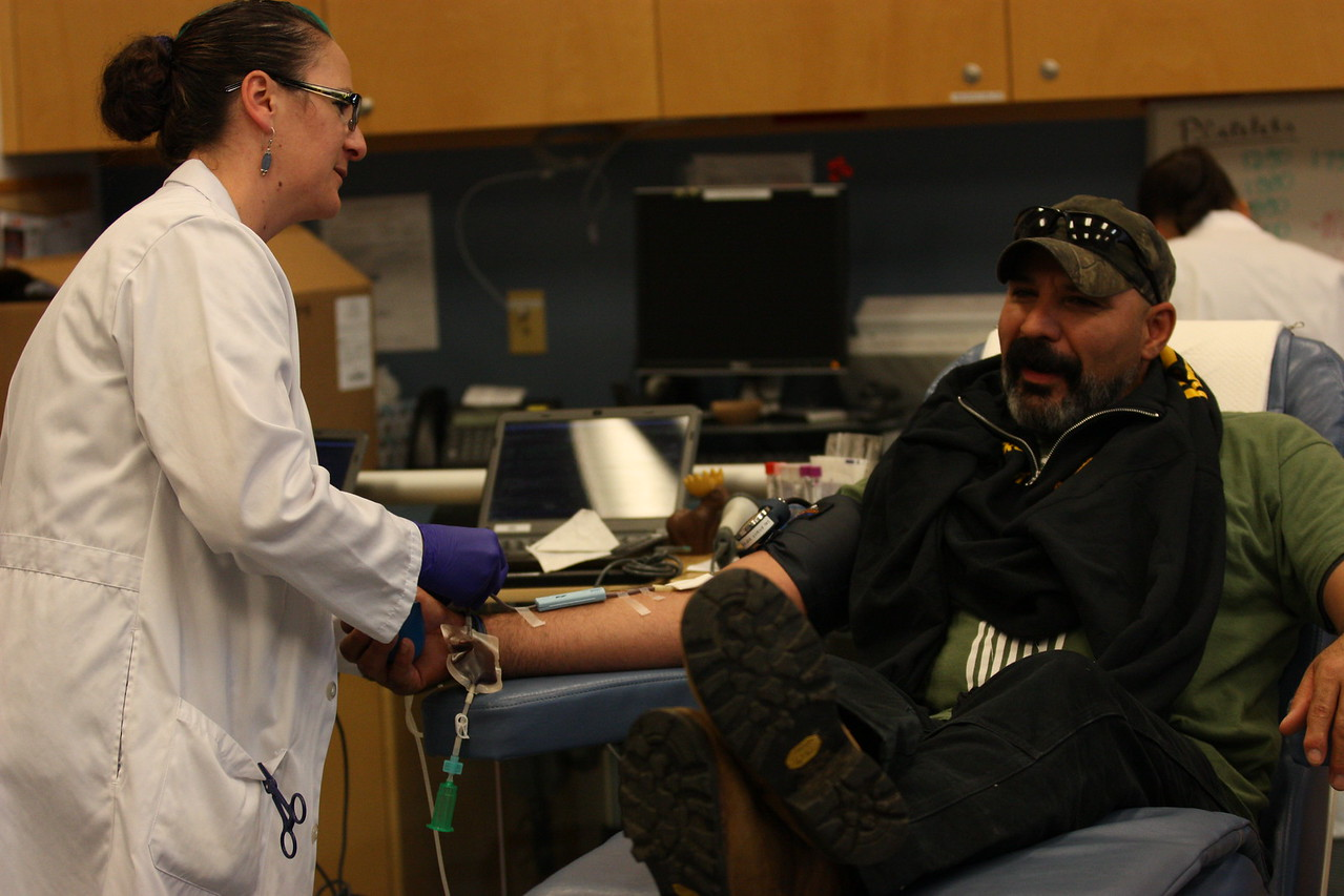 Eureka Police Problem Oriented Policing Sgt. Rodrigo Reyna-Sanchez is checked on as he donates blood at the Northern California Community Blood Bank on Wednesday during the Donate with the Captains Blood Drive. (Will Houston - The Times-Standard)