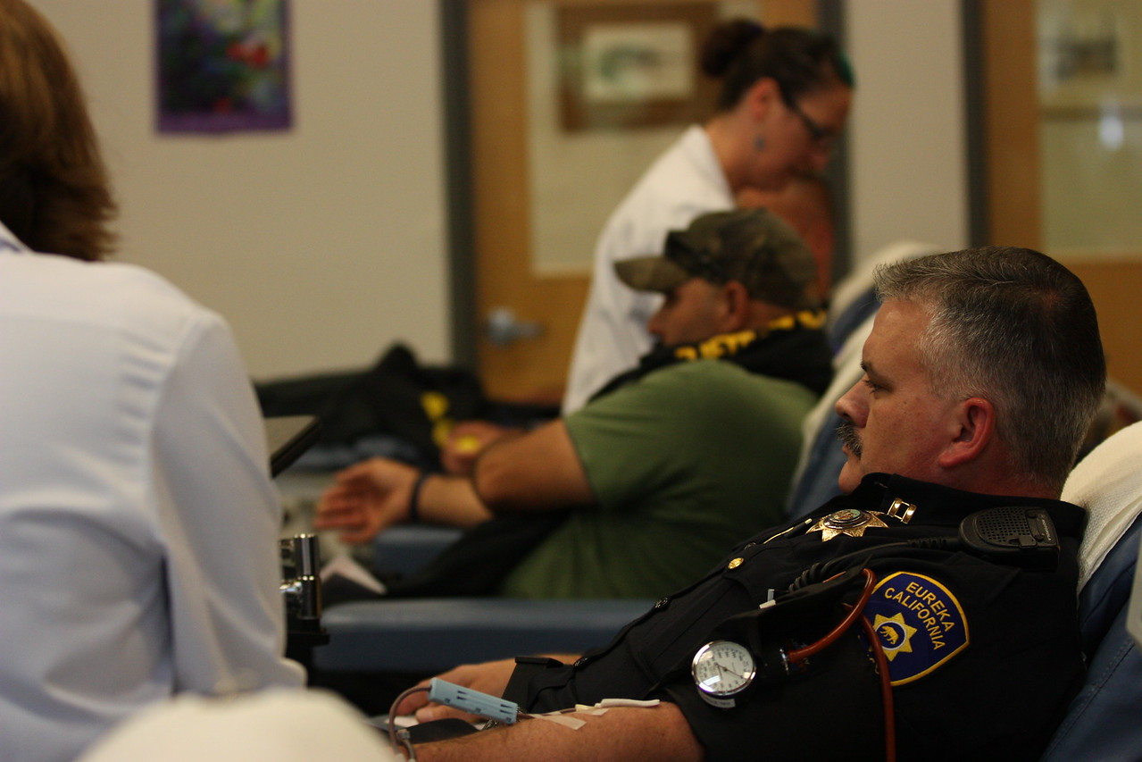 Eureka Police Capt. Brian Stephens (foreground) and EPD Problem Oriented Policing Sgt. Rodrigo Reyna-Sanchez sit back as they donate blood at the Northern California Community Blood Bank on Wednesday. (Will Houston - The Times-Standard)