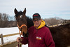 Stillwater, MN - Steve & Dorothy Erban of Premiere Stallions of Minnesota, owners of Kela, on their farm near the Twin Cities. Steve Erban with a yearling by Kela and out of Chassin Mason here today, Wednesday March 12, 2014.  Photo by © Todd Buchanan 2014 Technical Questions: todd@toddbuchanan.com