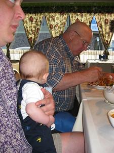 Albert watching Babu eat dinner