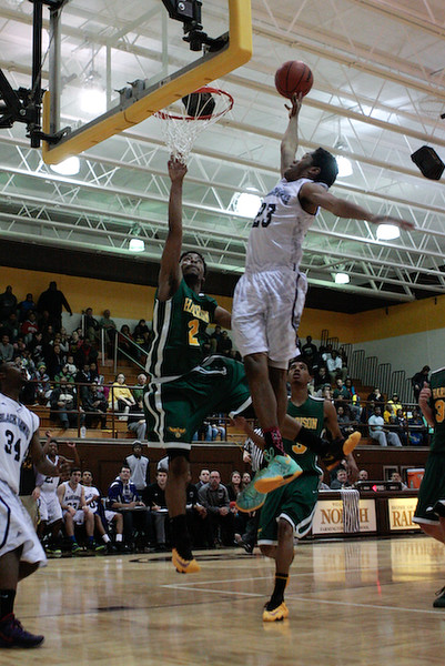 (Friday March 7th 2014 - North Farmington High School) Bloomfield HIlls' #23 Khalil Gracey jumps for a layup during the game against Harrison Friday night. Photo by: Brian B. Sevald