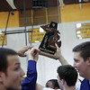 (Friday March 7th 2014 - North Farmington High School) Bloomfield HIlls' players hold the game trophy after winning the game against Harrison Friday night. Photo by: Brian B. Sevald