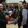 (Friday March 7th 2014 - North Farmington High School) Bloomfield HIlls' head coach Duane Graves (right) is presented with the game trophy after winning the game against Harrison Friday night. Photo by: Brian B. Sevald