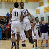 (Friday March 7th 2014 - North Farmington High School) Bloomfield HIlls' players celebrate winning the game against Harrison Friday night. Photo by: Brian B. Sevald