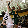 (Friday March 7th 2014 - North Farmington High School) Harrison's #5 Justin Whitted jumps for a layup during the game against Bloomfield Hills Friday night. Photo by: Brian B. Sevald