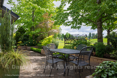 Small courtyard garden in backyard that opens onto a golf course. Garden concept and design by Darcy Daniels of Bloomtown Gardens. Landscape contruciton: Tryon Creek Landscape. Metal art screen: Gina Nash of Experienced Metals.