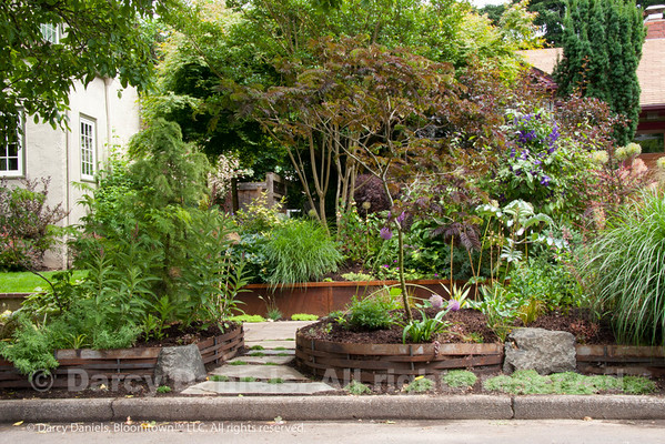 Raised Bed with Steel Weave in the home garden of Darcy Daniels. Garden Design: Darcy Daniels, Bloomtown Gardens. Landscape contractor: Pete Wilson Stoneworks.