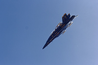 2 Blue Angel F18s in formation descending to do a pass over the crowd