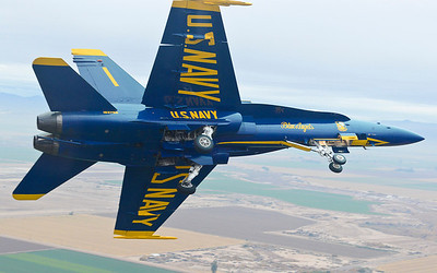 130124-N-SN160-510 EL CENTRO, Calif., (Jan. 24, 2013) U.S. Navy Flight Demonstration Squadron, the Blue Angels, Commanding Officer and Flight Leader Cmdr. Tom Frosch, from Clinton Township, Mich., prepares to land after leading the Diamond Formation over Naval Air Facility (NAF) El Centro, Calif., during a training sortie Jan. 24 The Blue Angels are currently conducting winter training where pilots must complete 120 practice flights before kicking off the 2013 air show season at NAF El Centro March 16. (U.S. Navy photo by Mass Communication Specialist 2nd Class Michael Lindsey/Released)