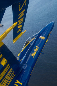 """120615-N-BA418-048 BALTIMORE (June 15, 2012) Capt. Brandon Cordill, left wingman of the U.S. Navy flight demonstration squadron, the Blue Angels, flies with the canopy of his F/A-18 Hornet approximately 18 inches from the wingtip of Capt. Greg McWherter during the """"diamond 360"""" maneuver over Baltimore's Inner Harbor during the Star Spangled Sailabration. The Sailabration coincides with Baltimore Fleet Week 2012 and commemorates the War of 1812 and the writing of the """"Star Spangled Banner."""" (U.S. Navy photo by Mass Communication Specialist 2nd Class Andrew Johnson/Released)"""