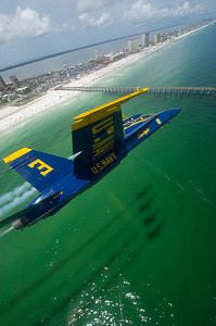 120712-N-BA418-109 PENSACOLA, Fla. (July 12, 2011) The U.S. Navy flight demonstration squadron, the Blue Angels, perform a practice flight demonstration over Pensacola Beach. The Blue Angels 2012 performances are in celebration of the Marine Aviation Centennial and commemoration of the bicentennial of the War of 1812. (U.S. Navy photo by Mass Communication Specialist 2nd Class Andrew Johnson/Released)