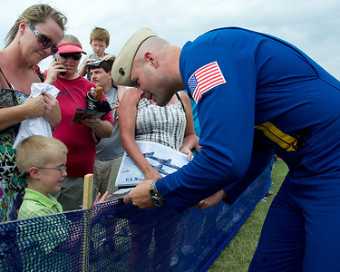 120610-N-LD780-921 MANKATO, Min. (June 10, 2012) Fat Albert Pilot, Capt. A. J. Harrell, U.S. Navy Flight Demonstration Squadron, the Blue Angels, signs autographs after performing a flight demonstration at the Minnesota Air Spectacular 2012, Mankato, Min., air show June 10. (U.S. Navy photo by Mass Communication Specialist 1st Class Eric Rowley/Released)