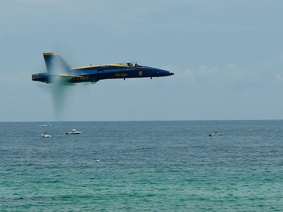 PENSACOLA BEACH, Fla. (July 13, 2012) Lt. C.J. Simonsen, lead solo pilot for the U.S. Navy flight demonstration squadron, the Blue Angels, performs a Sneak Pass approximately 50 feet above the Gulf of Mexico during a practice demonstration in preparation for the upcoming Pensacola Beach Air Show. (U.S. Navy photo by Mass Communication Specialist 1st Class Eric Rowley/Released)