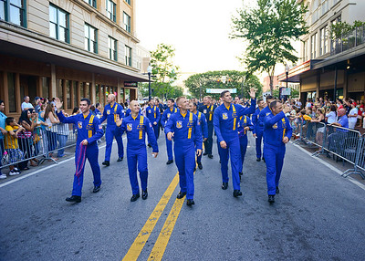 PENSACOLA, Fla. (June 6, 2013) -- U.S. Navy Flight Demonstration Squadron, the Blue Angels, team members wave to the crowd in the Fiesta Day Parade, a part of the Fiesta of Five Flags that celebrates the founding of Pensacola in 1559. The Blue Angels have called Pensacola home since 1954 and although budget cuts have forced the cancellation of 2013 air shows and practice demonstrations, they are still committed to their mission of enhancing Navy recruiting, and representing the Navy and Marine Corps aviation in their local community. (U.S. Navy photo by Mass Communication Specialist 1st Class Terry Siren/Released)