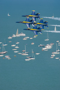 120818-N-BA418-095 CHICAGO (Aug. 18, 2012) U.S. Navy Flight Demonstration Squadron, the Blue Angels, pilots perform the Diamond 360 maneuver over Lake Michigan at the Chicago Air & Water Show as part of the 2012 air show season. (U.S. Navy photo by Mass Communication Specialist 2nd Class Andrew Johnson/Released)