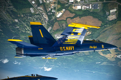 120330-N-BA418-048 TUSCALOOSA, Ala. (March 30, 2012) Capt. Greg McWherter, commanding officer and flight leader for the U.S. Navy flight demonstration squadron, the Blue Angels, leads a formation of F/A-18 Hornets during the Tuscaloosa Regional Air Show 2012. The Tuscaloosa Regional Air Show was the fourth show site of the squadron's 2012 season. (U.S. Navy photo by Mass Communication Specialist 2nd Class Andrew Johnson/Released)